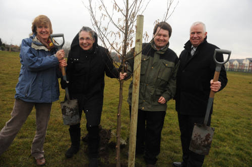 Diana Scotcher (Sustainable Living in the Heatons), Ann Coffey MP, Councillor Dean Fitzpatrick and Stagecoach Manchester's managing director, Christopher Bowles brave the cold to plant one of the eight trees.