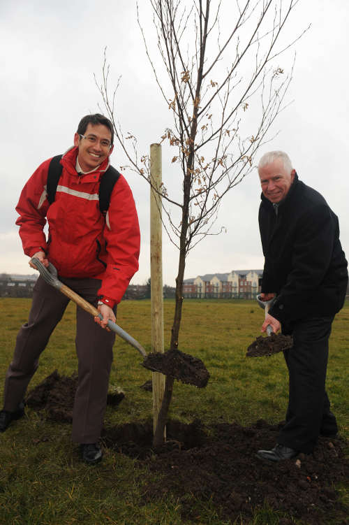 Simon Ho of TfGM joins Stagecoach Manchester's managing director, Christopher Bowles to dig a hole for one of the eight trees to celebrate the launch of 40 buses