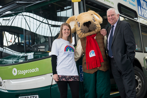 A New Partnership: Emma Siddle and mascot, from Francis House seen with Christopher Bowles, Stagecoach Manchester MD