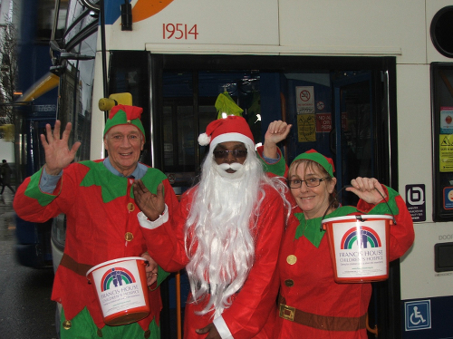 Festive Spirit: Stagecoach Manchester staff John Cailey, Junior Grant and Sheila Chaisty get festive for Francis House. (Image © 2014 Tangerine PR Ltd)