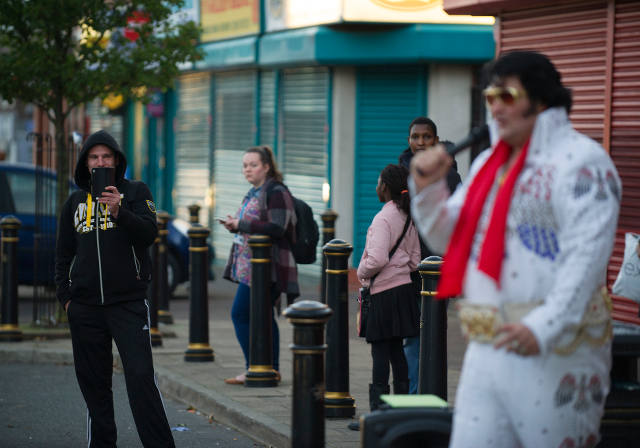 There's a guy stood by the bus stop who swears he's Elvis.