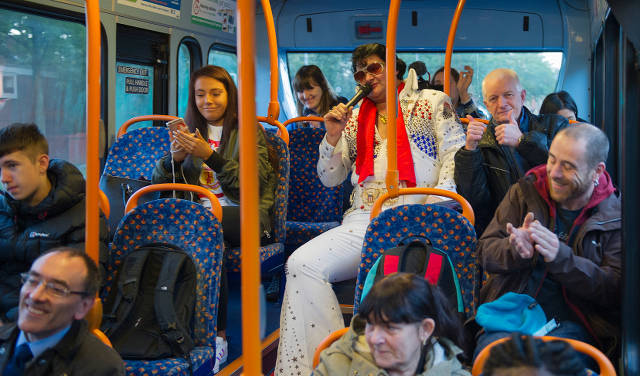 Elvis' audience of passengers heading towards Manchester city centre.