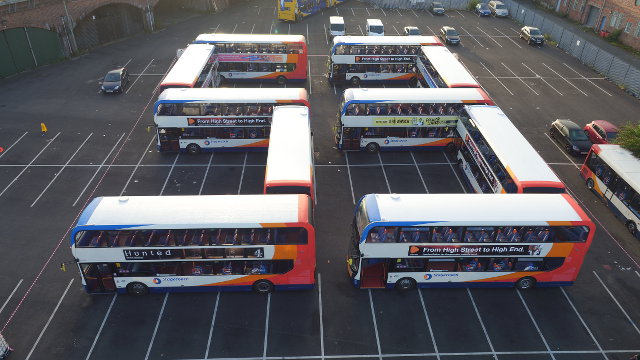 A selection of Enviro400 MMC buses making up the number 53.